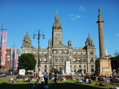 George Square is the centerpiece of Glasgow with Neoclassical City Chambers and tall monument to Sir Walter Scott