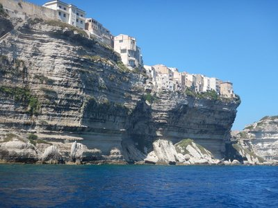 From a boat, you get a much greater appreciation of how the buildings overhang the water in Bonafacio