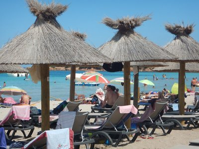 Rondinara Beach had nice palapas but they were expensive; the shade is a smart idea since the sun is unrelenting here
