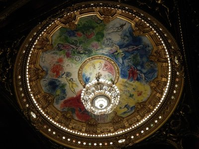 The original ceiling in the auditorium melded better with the overall aesthetics; this new ceiling was painted by Chagall in 1964 which met with instant disapproval by the French