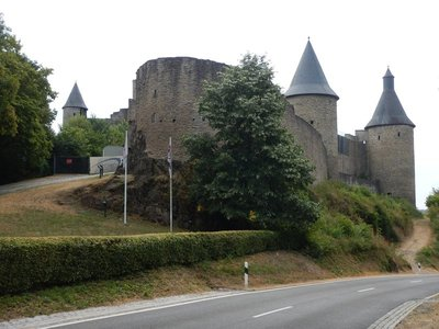 Bourscheid Castle was built around the year 1000; the castle stands 500 feet above the River Sure and is enclosed by a circular wall with 11 watchtowers