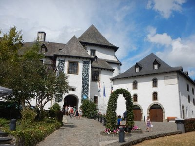 Clervaux Castle stands at a height of 365 meters on a rocky spur above the town, surrounded on 3 sides by a loop in the River Clerve
