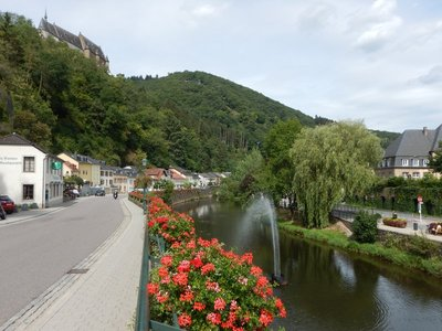 The residential part of Vianden primarily lines the riverfront streets on either side of the Our River; there were tiny fish in the shallow river
