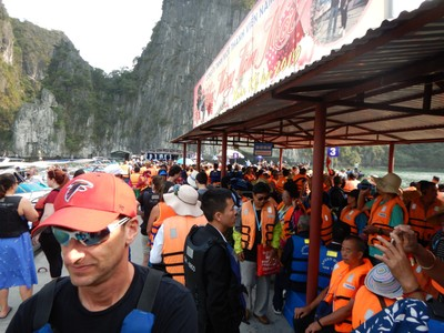 There were thousands of people waiting to kayak or take a rowboat but we were able to bypass the line; Halong Bay was just way too crowded!