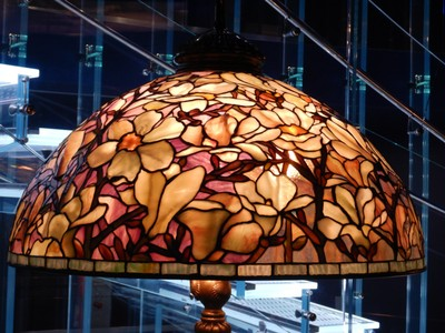 Magnolia Shade (ca. 1906-10); the jewel-like lamps made by Tiffany Studios are icons of early 20th century American design; Tiffany pioneered artistic lighting for the then-recent invention of incandescent light bulbs