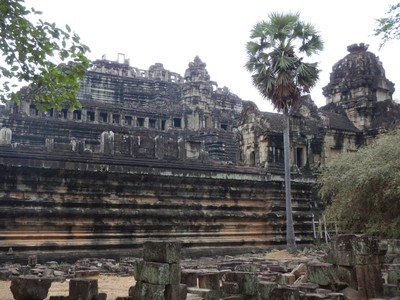 Baphuon, part of Angkor Thom,  is one of the largest and grandest structures in Angkor; built in the mid-11th century, it is a three-tiered temple dedicated to the Hindu god Shiva
