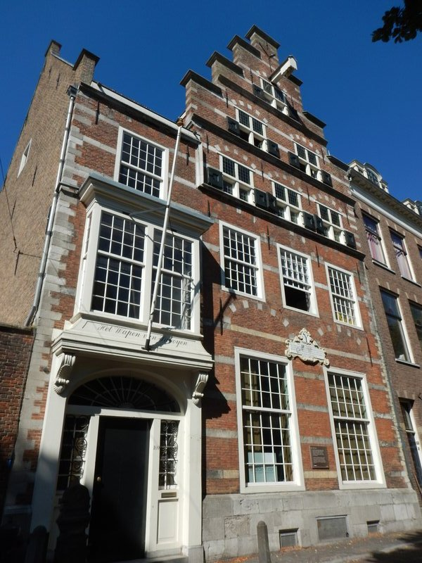 Large private house originally built in 1565; the entrance was altered in the 18th century when it became the Latin School