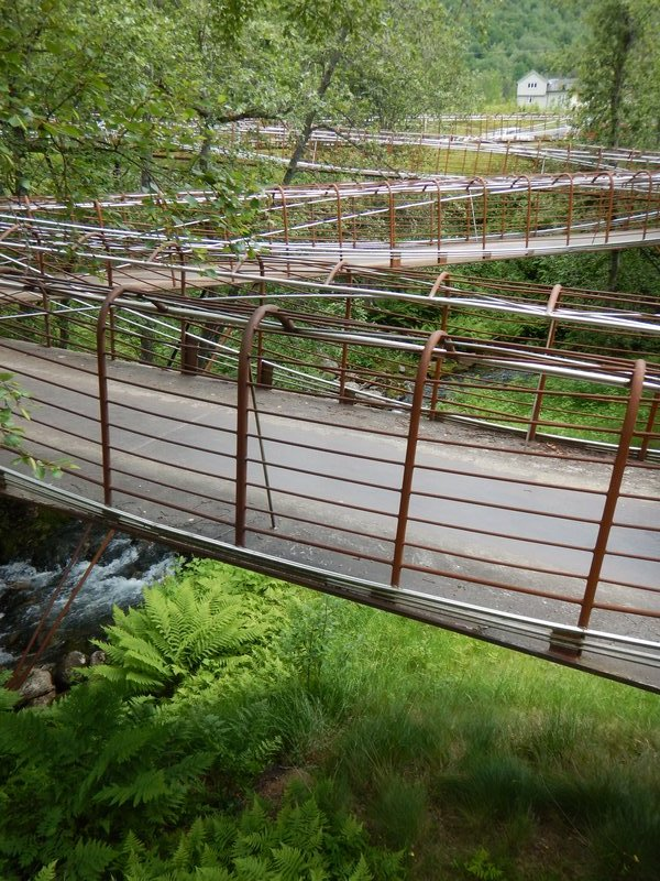 Serpentine, rust-corroded iron walkway at Gudbrandsjuvet reflects priority Norwegians place on their surroundings
