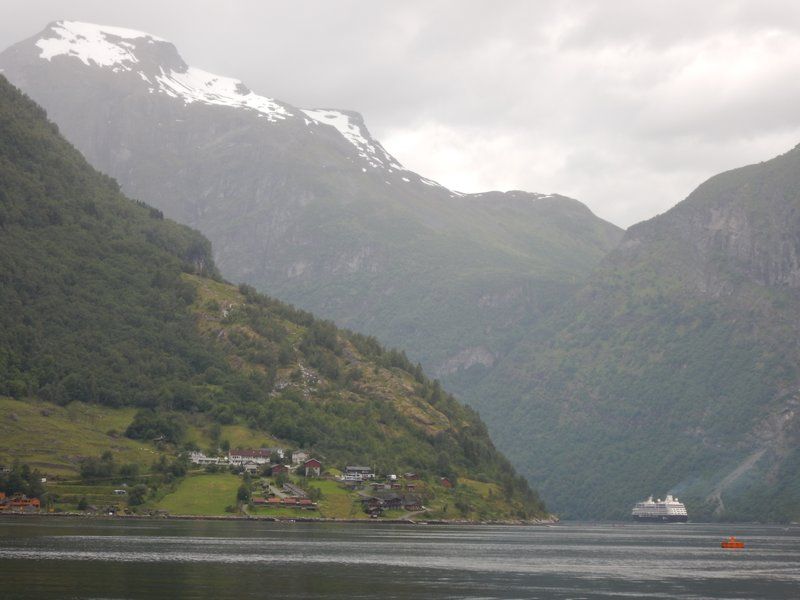 Dramatic mountains are more than 1700 meters high while fjord is 260 meters deep; fjord is one of Norway's most popular natural attractions