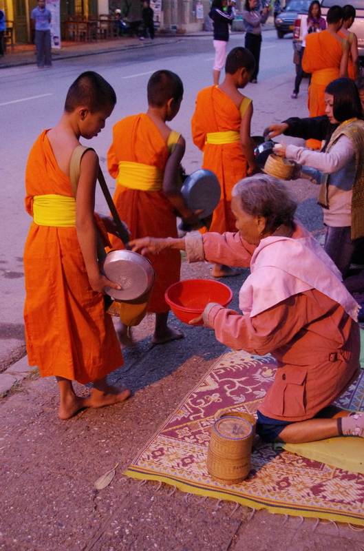 A dawn ritual in Luang Prabang - donating breakfast to the monks