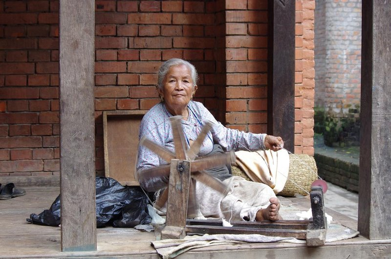 Woman spinning cotton