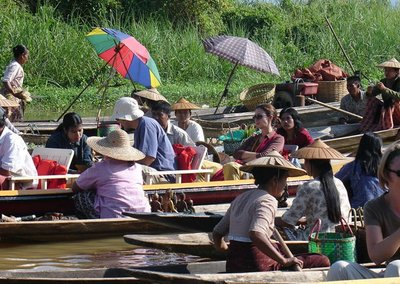 bying and selling in floating market,Inle