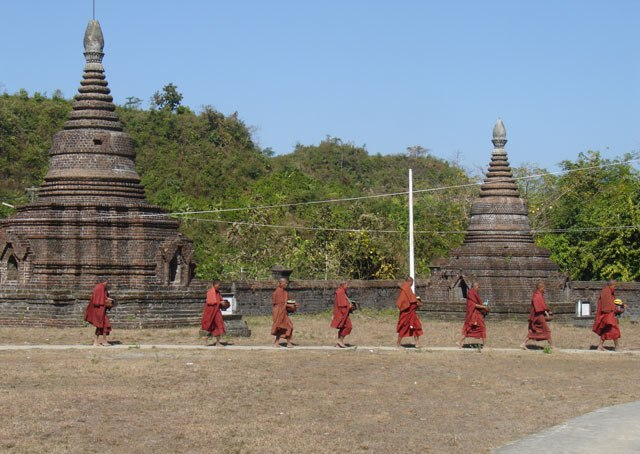 While monks asking donation for their lunch