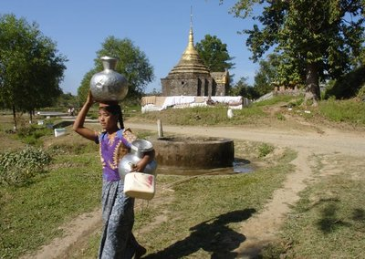 Local Village girl carring a steal water pot