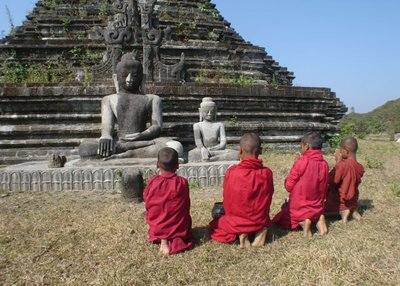 young monks praying