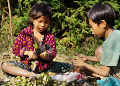 Young children peel nuts beside the road above Yen Minh, North East Vietnam, 30 September 2012