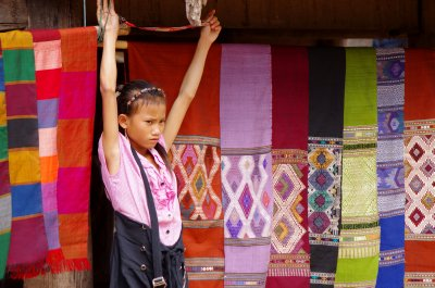 Scarf selling in a village on the Nam Ou River