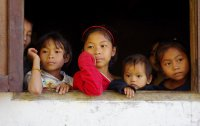 Children watch us eat lunch number one near the Mekong