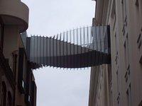 interesting contrast of style...cool footbridge too!