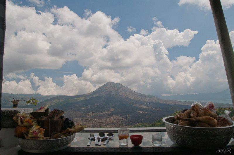 Hindu offerings of fruit, meat and snacks overlooking Batung volcano