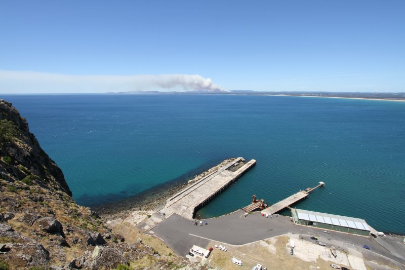Harbour view from The Nut with bushfire in the distance