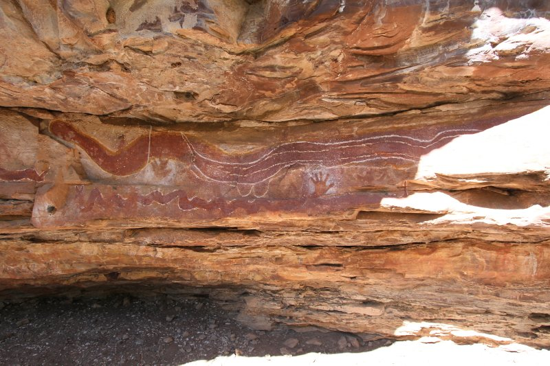 Rock paintings with real snake skin