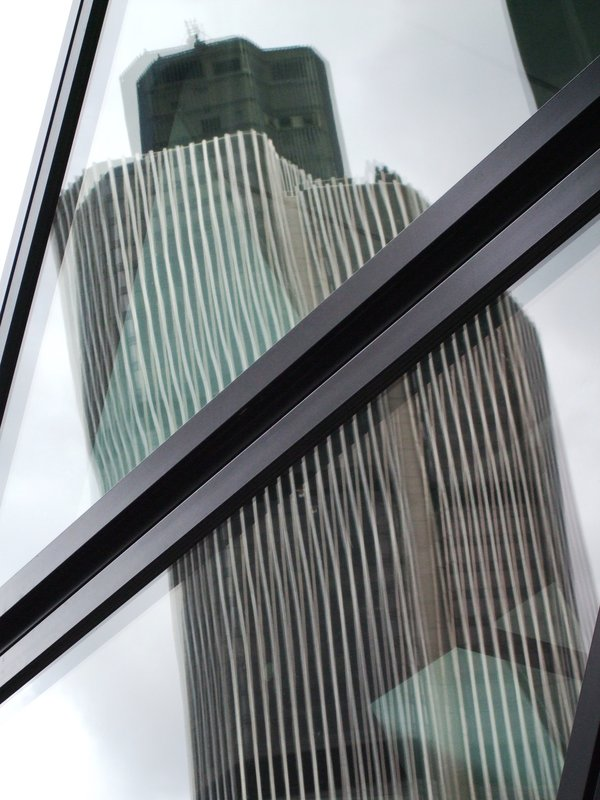 Tower 42 reflected on the Gherkin