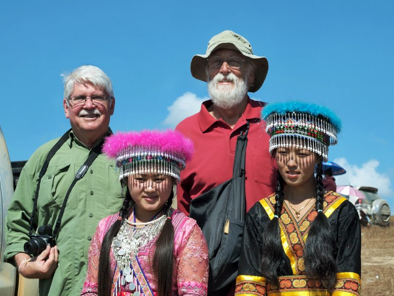 Charlie and Mike posing with Hmong girls