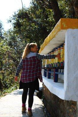 Kerri moving the Tibetan prayer wheels