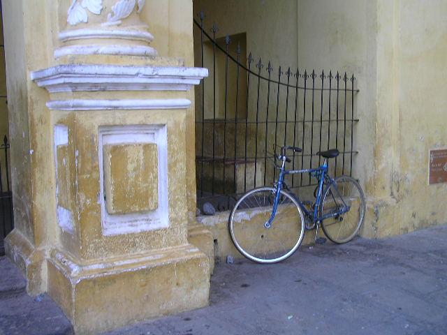 GUATEMALA - Antigua - yellow church - bicycle