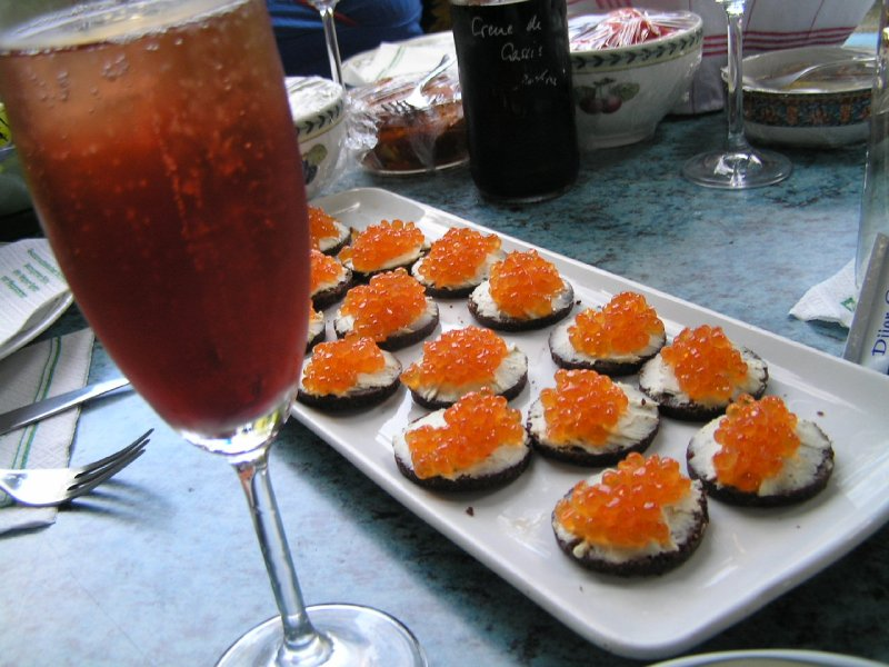 Shampain with blackberry liqueur and caviar