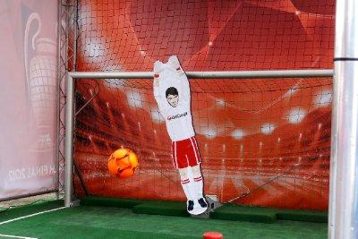 The goalie stops the shot