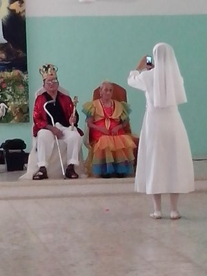 Nun at the anceanos getting a shot of the king and queen
