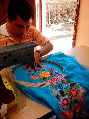 Embroidery at Kimbala. by machine but guided by hand