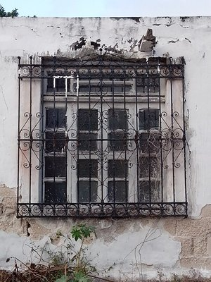 Lovely old ironwork window grill in Chicxulub