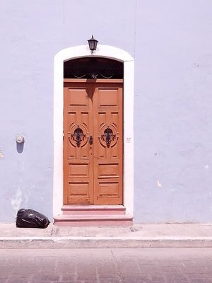 lovely Campeche door...too bad there's a garbage bag to go