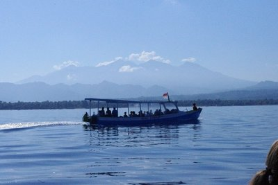 The morning boat from Gili Air to Lombok harbour, with Gunung Rinjani in the background