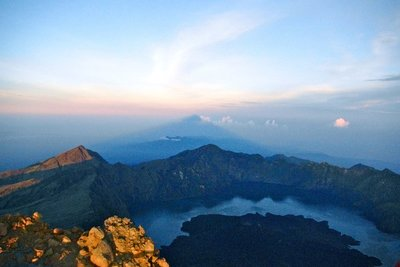 The shadow of Gunung Rinjani and Gunung Agung, Bali in the distance