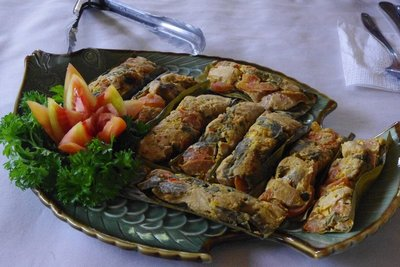 Fish smothered in spices and cooked in banana leaves