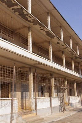 The outside of the school buildings - covered in barbed wire to prevent escape and suicide