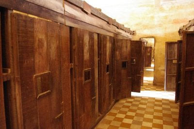 Some of the classrooms had been made into small wooden or brick cells