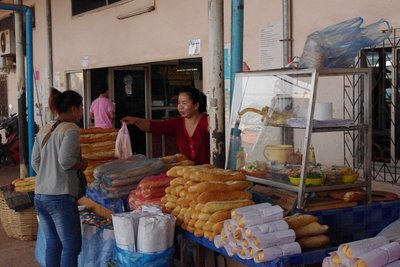 Baguette anyone? Breakfast at the bus station Laos style