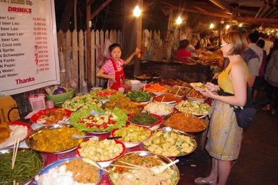 Hhhmmmm...what won't give me food poisoning. Eating off the street in Luang Prabang for £1!