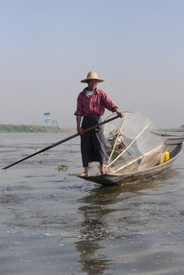 Inwa Lake fisherman setting his nets in the morning