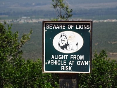 """Warning sign at a viewpoint. It is always """"Leave vehicle at your own risk"""" while in the park."""