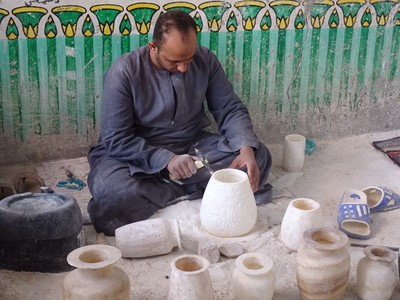 Working on an alabaster vase