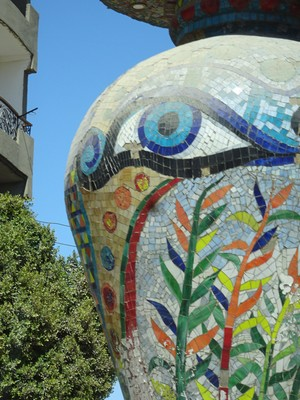 A huge tiled urn on the street in Qena