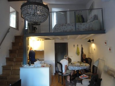 View of kitchen with loft above