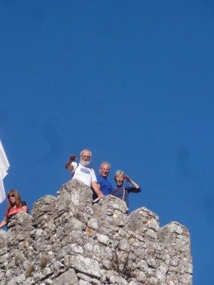 Three climbers on a tower