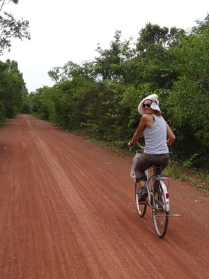 My friend Flo, as we cycled along a track in Angkor Wat.